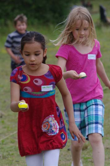 Egg-race-running-sports-day-Girl-in-golden-dress-CM2-play-Fontainebleau-International-Schools-Anglophone-Section